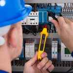Examining Fusebox with Voltage Tester